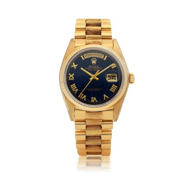 ROLEX     DAY-DATE, REF 18038 YELLOW GOLD WRISTWATCH WITH DAY, DATE, BRACELET AND BLUE HARDSTONE DIAL CIRCA 1978