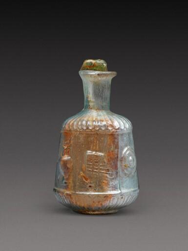 View 3. Thumbnail of Lot 4. A Roman Pale Green Mould-Blown Glass Flask, circa 1st century A.D..