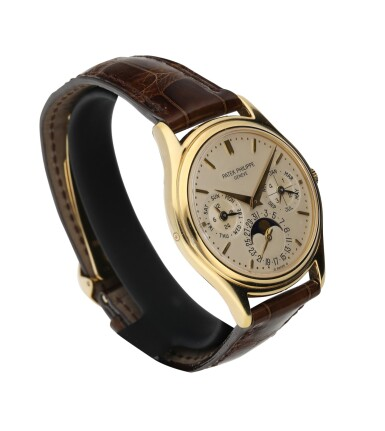 View 2. Thumbnail of Lot 52. PATEK PHILIPPE | REFERENCE 3941 A YELLOW GOLD AUTOMATIC PERPETUAL CALENDAR WRISTWATCH WITH MOON PHASES, CIRCA 1990.