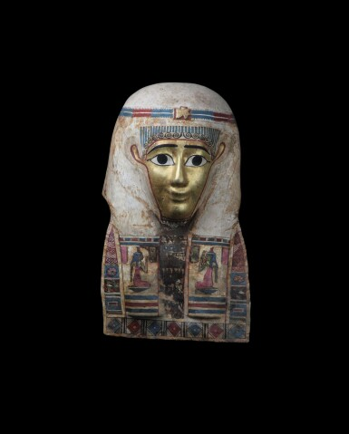 View 1. Thumbnail of Lot 35. An Egyptian Polychrome and Gilt Cartonnage Mummy Mask, late Ptolemaic Period, circa 100-30 B.C..