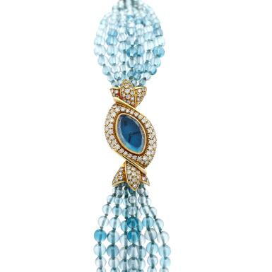 View 1. Thumbnail of Lot 95. A yellow gold and diamond-set watch with blue topaz beads bracelet, Circa 1995 .