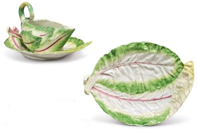 A CHELSEA LETTUCE SAUCEBOAT AND TWO STANDS, CIRCA 1755