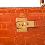 Hermès Pain d'Epice Shiny Sellier Kelly 28cm of Shiny Porosus Crocodile with Gold Hardware