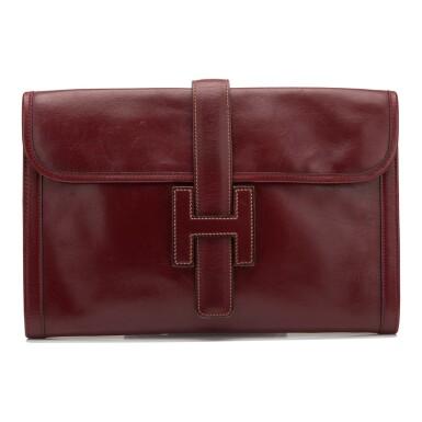 View 1. Thumbnail of Lot 24. Hermès Vintage Rouge H Box Jige Elan Clutch 29cm.