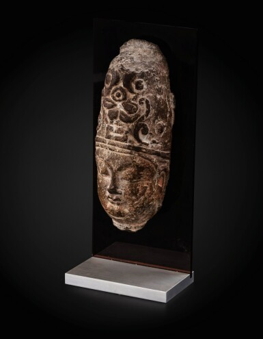 View 2. Thumbnail of Lot 23. An important fragmentary relief head of an attendant Sui dynasty-Tang dynasty, ca. 7th century   隋至唐 約七世紀 石浮雕神首殘件.