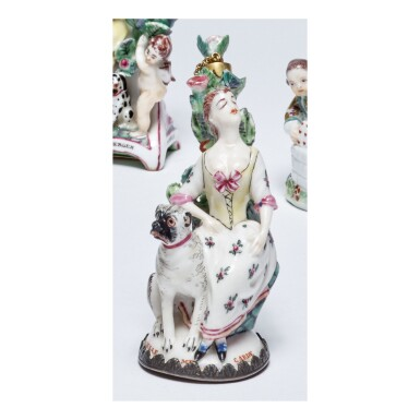 A ST. JAMES'S (CHARLES GOUYN) PORCELAIN SCENT BOTTLE IN THE FORM OF A SLEEPING GIRL AND MASTIFF CIRCA 1750-54