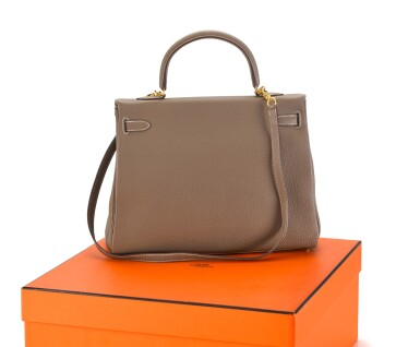 View 2. Thumbnail of Lot 8. KELLY 35 RETOURNE ETOUPE COLOUR IN TOGO LEATHER WITH GOLD HARDWARE. HERMÈS, 2017 .
