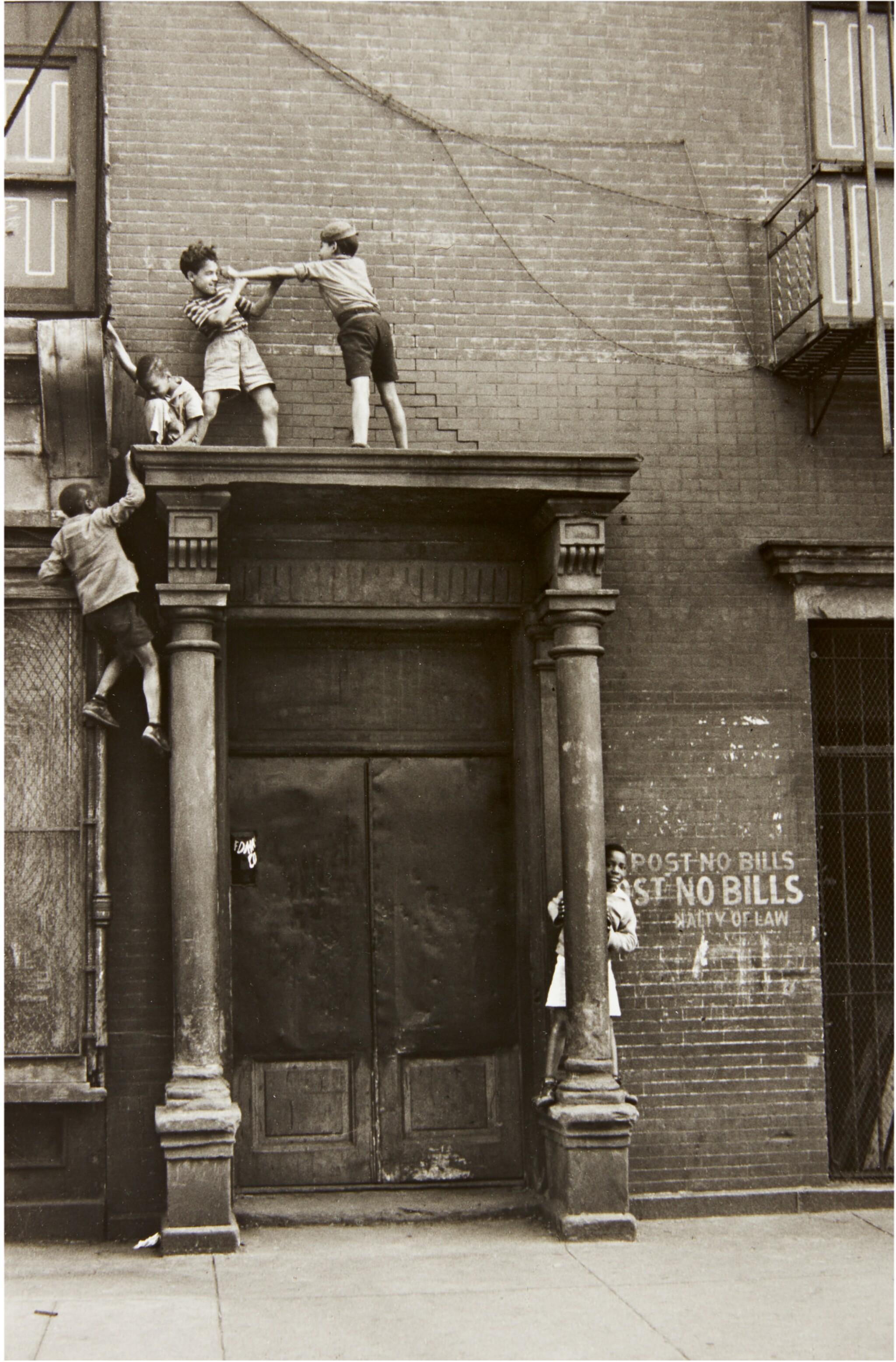 View full screen - View 1 of Lot 37. HELEN LEVITT | NEW YORK (BOYS ON A PEDIMENT).
