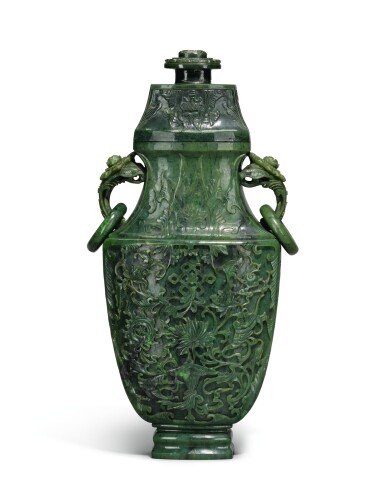 View 2. Thumbnail of Lot 222. A large spinach jade vase and cover, Qing Dynasty, Qianlong period   清乾隆 碧玉番蓮八吉祥紋活環耳蓋瓶.