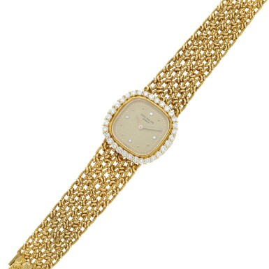 View 6. Thumbnail of Lot 99. Reference 4524/1  A yellow gold and diamond-set cushion shaped wristwatch, Circa 1982.