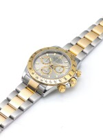 ROLEX   REF 116523 DAYTONA, A STAINLESS STEEL AND YELLOW GOLD AUTOMATIC CHRONOGRAPH WRISTWATCH WITH REGISTERS AND BRACELET CIRCA 2003