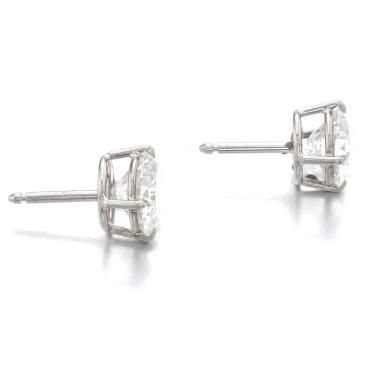 View 2. Thumbnail of Lot 1172. Pair of diamond ear studs.