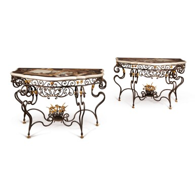 A PAIR OF SPANISH BAROQUE STYLE PIETRE DURE AND PARCEL-GILT WROUGHT IRON CONSOLE TABLES, THE TOPS AFTER THE BUEN RETIRO WORKSHOP