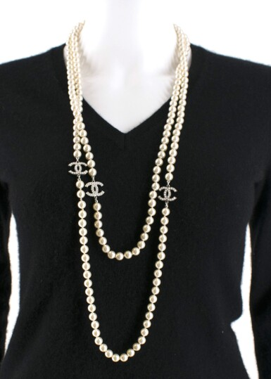 View 10. Thumbnail of Lot 165. CHANEL | IVORY FAUX PEARL DOUBLE STRAND NECKLACE WITH FAUX PEARL EMBELLISHED CC PENDANTS AND LOBSTER CLASP CLOSURE, 2012.