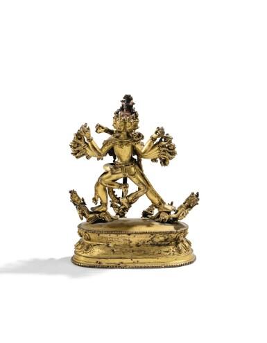 STATUETTE DE HEVAJRA EN ALLIAGE DE CUIVRE DORÉ NÉPAL, XVE SIÈCLE | 尼泊爾 十五世紀 鎏金銅合金喜金剛立像 | A rare gilt-copper alloy figure of Hevajra, Nepal, 15th century