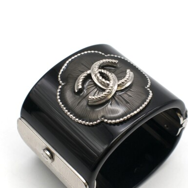View 3. Thumbnail of Lot 174. CHANEL | BLACK PERSPEX CUFF WITH A RESIN FILLED CAMELIA STUDDED FLORAL OUTLINE AND ANTHRACITE TONE HARDWARE AND CC EMBELLISHMENT, 2015.