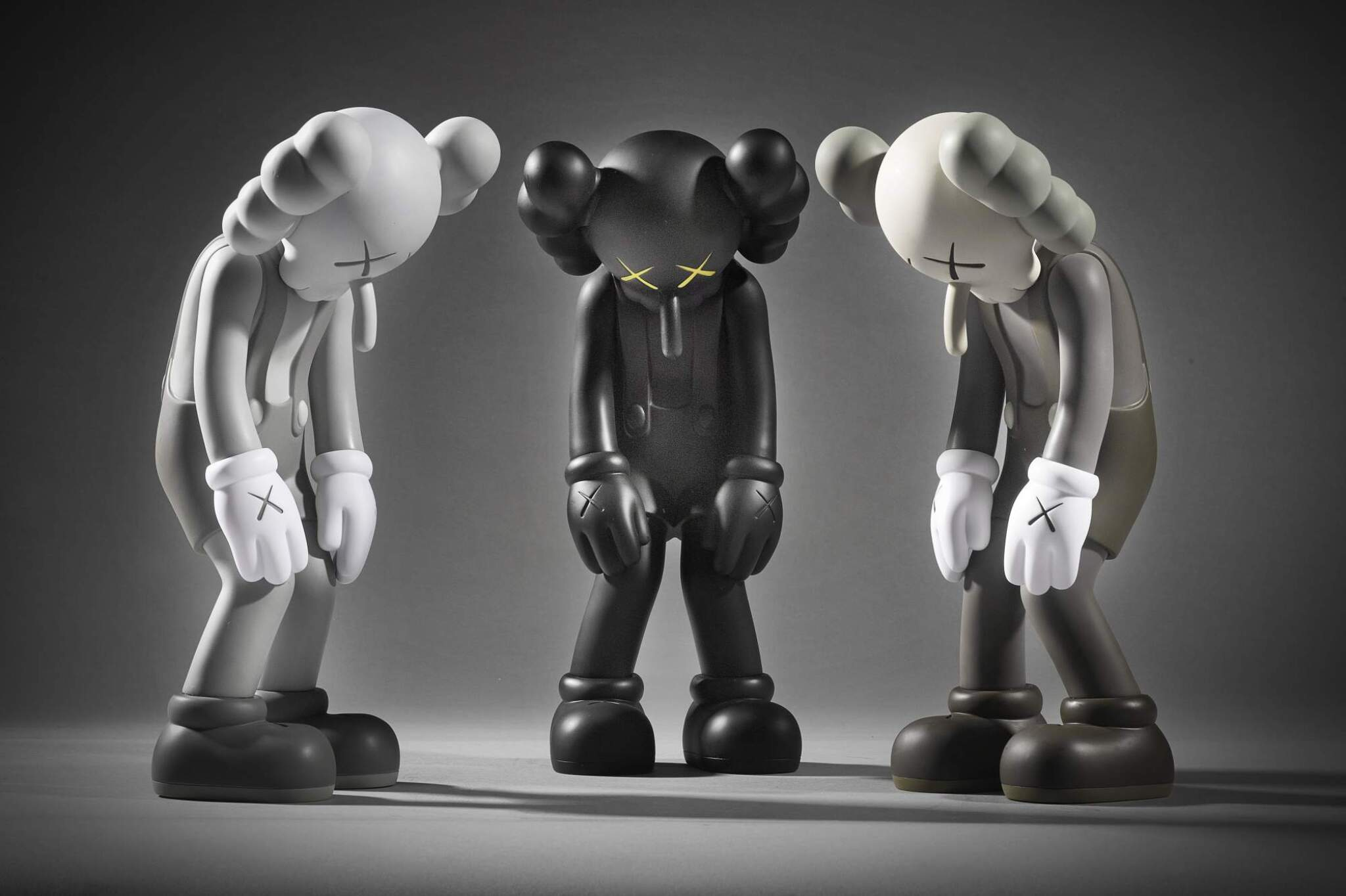 View full screen - View 1 of Lot 504. KAWS   THREE WORKS: (I) SMALL LIE (BROWN); (II) SMALL LIE (BLACK); (III) SMALL LIE (GREY).