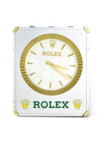 ROLEX | A STAINLESS STEEL AND BRASS BUILDING SIGN CLOCK, CIRCA 1970