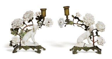 View 1. Thumbnail of Lot 143. A pair of 'Girl-in-a-Swing' porcelain and tole peint-mounted candlesticks, circa 1755, Charles Gouyn's factory, St. James's.