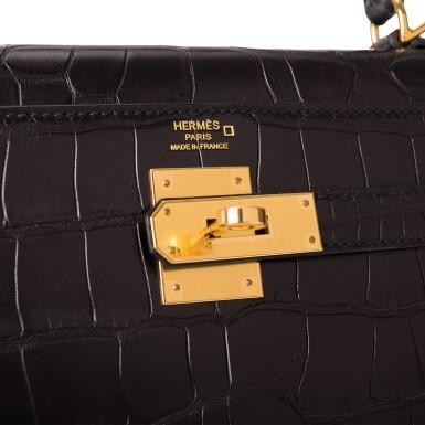 View 7. Thumbnail of Lot 44. Hermès Black Retourne Kelly 28cm of Matte Alligator with Gold Hardware.
