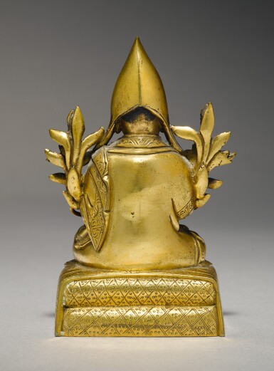 View 2. Thumbnail of Lot 338. A GILT COPPER ALLOY FIGURE OF A GELUKPA LAMA, TIBETO-CHINESE, 18TH CENTURY.