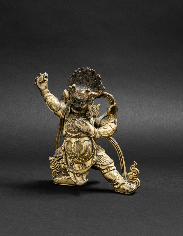 View 1 of Lot 47. Figure de Begtse en bronze doré Dynastie Qing, XVIIIE siècle | 清十八世紀 鎏金銅大紅司命主立像 | A git-bronze figure of Begtse, Qing Dynasty, 18th century.