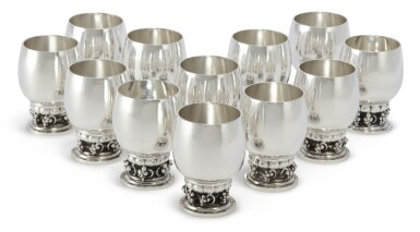 A SET OF TWELVE SMALL DANISH SILVER GRAPEVINE PATTERN GOBLETS, NO. 296B, DESIGNED BY GEORG JENSEN, GEORG JENSEN SILVERSMITHY, COPENHAGEN, CIRCA 1945-77