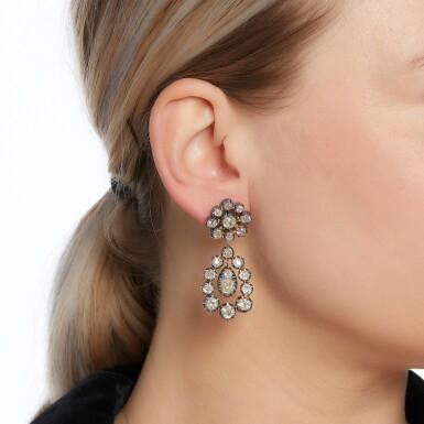 View 4. Thumbnail of Lot 81. Pair of diamond earrings.