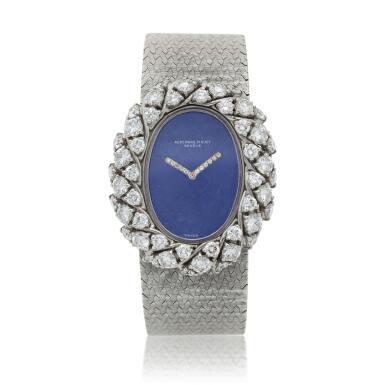 View 1. Thumbnail of Lot 158. A white gold and diamond-set bracelet watch with lapis lazuli dial, Circa 1980.