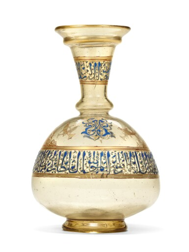 View 1. Thumbnail of Lot 449. A HIGHLY IMPORTANT MAMLUK GILDED AND ENAMELLED GLASS FLASK, SYRIA, MID-13TH CENTURY.