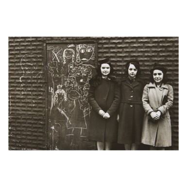 View 1. Thumbnail of Lot 155. HELEN LEVITT | THREE YOUNG WOMEN AGAINST WALL WITH CHALK DRAWING.