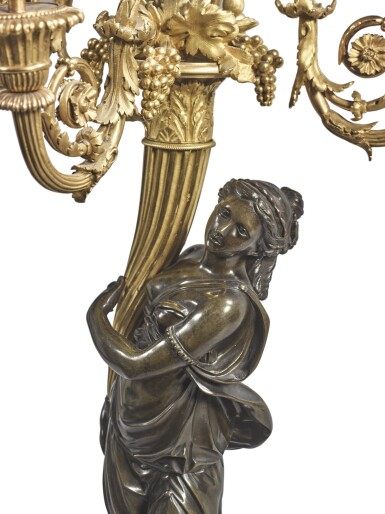 View 2. Thumbnail of Lot 825. A PAIR OF LOUIS XVI GILT AND PATINATED BRONZE FOUR-LIGHT FIGURAL CANDELABRA ATTRIBUTED TO FRANCOIS REMOND, CIRCA 1785.