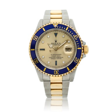 View 1. Thumbnail of Lot 9. Reference 16613 Submariner  A yellow gold and stainless steel wristwatch with date, bracelet and diamond and sapphire-set indexes, Circa 1990 .