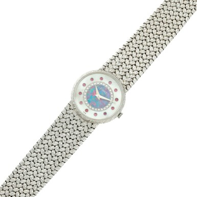 View 7. Thumbnail of Lot 109. Reference 9005 D 2 A white gold, mother-of-pearl, opal, diamond and ruby-set bracelet watch, Circa 1975.
