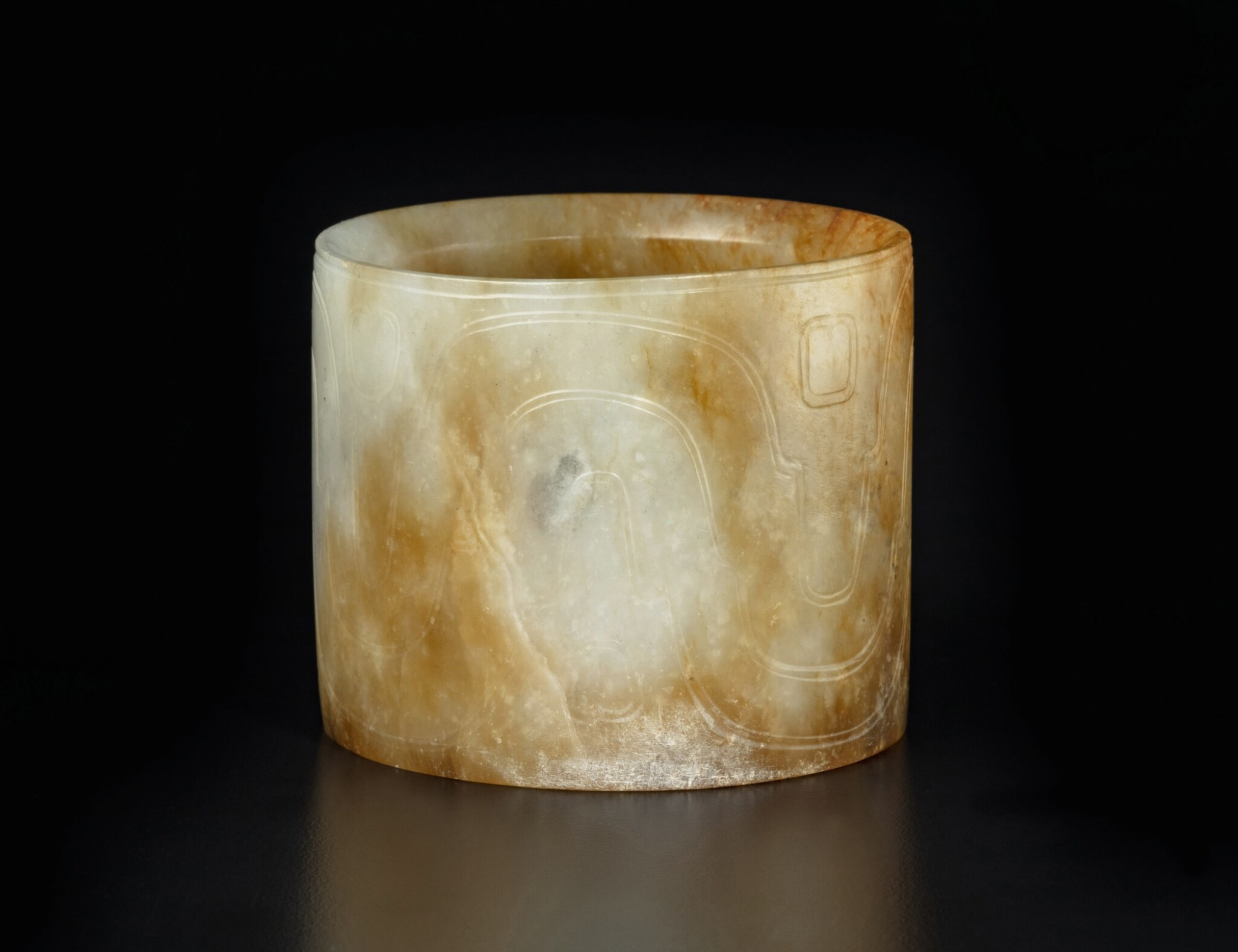 View full screen - View 1 of Lot 49. A rare pale gray and russet jade bracelet, Western Zhou dynasty | 西周 玉波曲紋鐲.