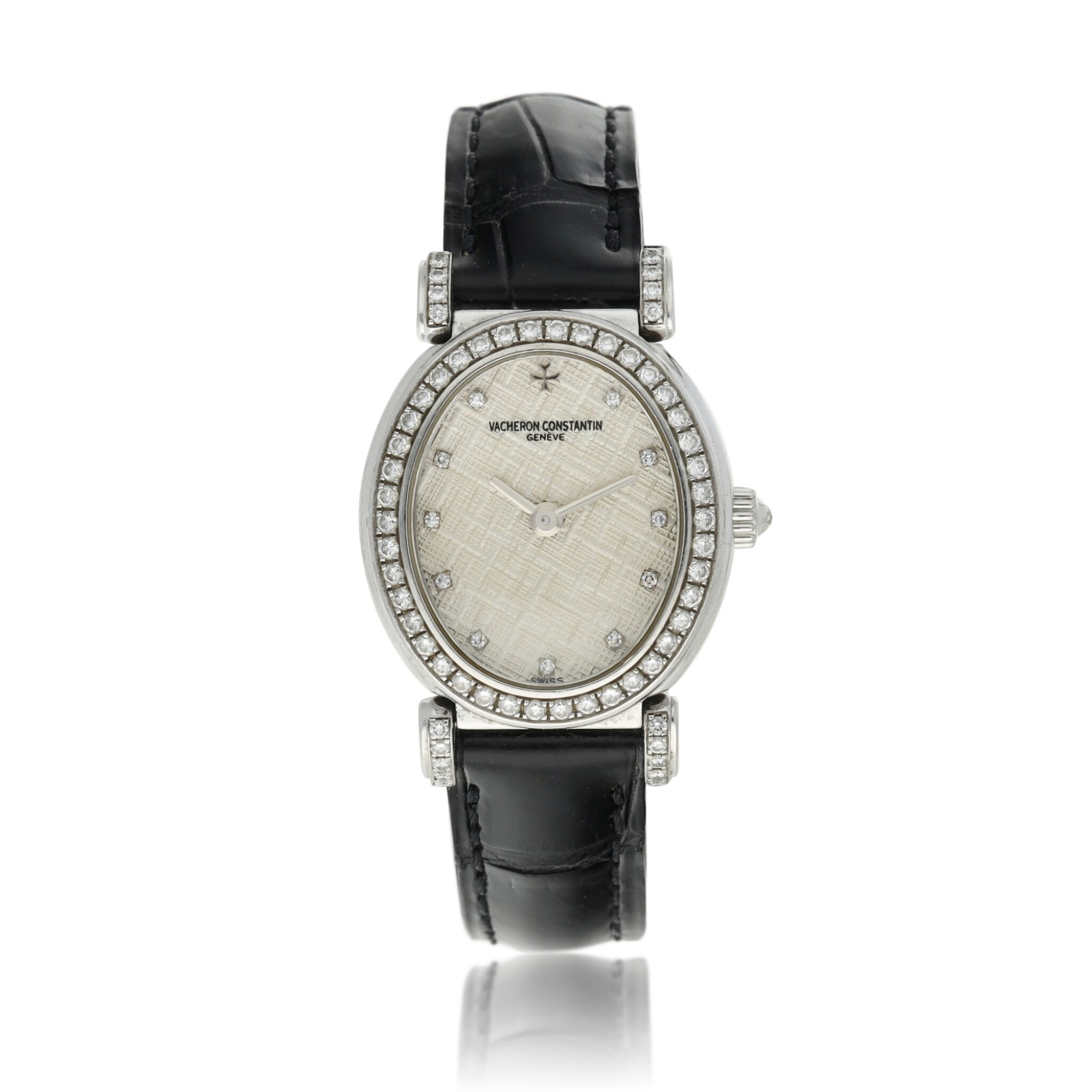 View full screen - View 1 of Lot 92. Reference 10540   A white gold and diamond-set oval wristwatch, Circa 1994.