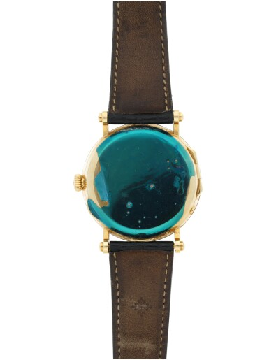 View 4. Thumbnail of Lot 164. PATEK PHILIPPE   REFERENCE 5015  A YELLOW GOLD AUTOMATIC WRISTWATCH WITH MOON PHASES AND POWER RESERVE, MADE IN 1996.