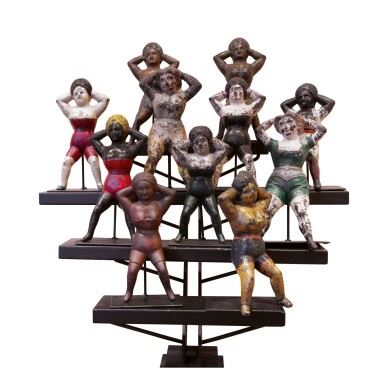 GROUP OF ELEVEN POLYCHROME PAINT-DECORATED CAST IRON 'NAUGHTY NELLIE' BOOT JACKS, LATE 19TH CENTURY