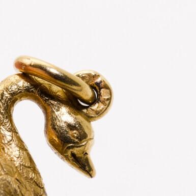 View 3. Thumbnail of Lot 16. A Fabergé gold and purpurine egg pendant, workmaster Erik Kollin, St Petersburg, circa 1890.