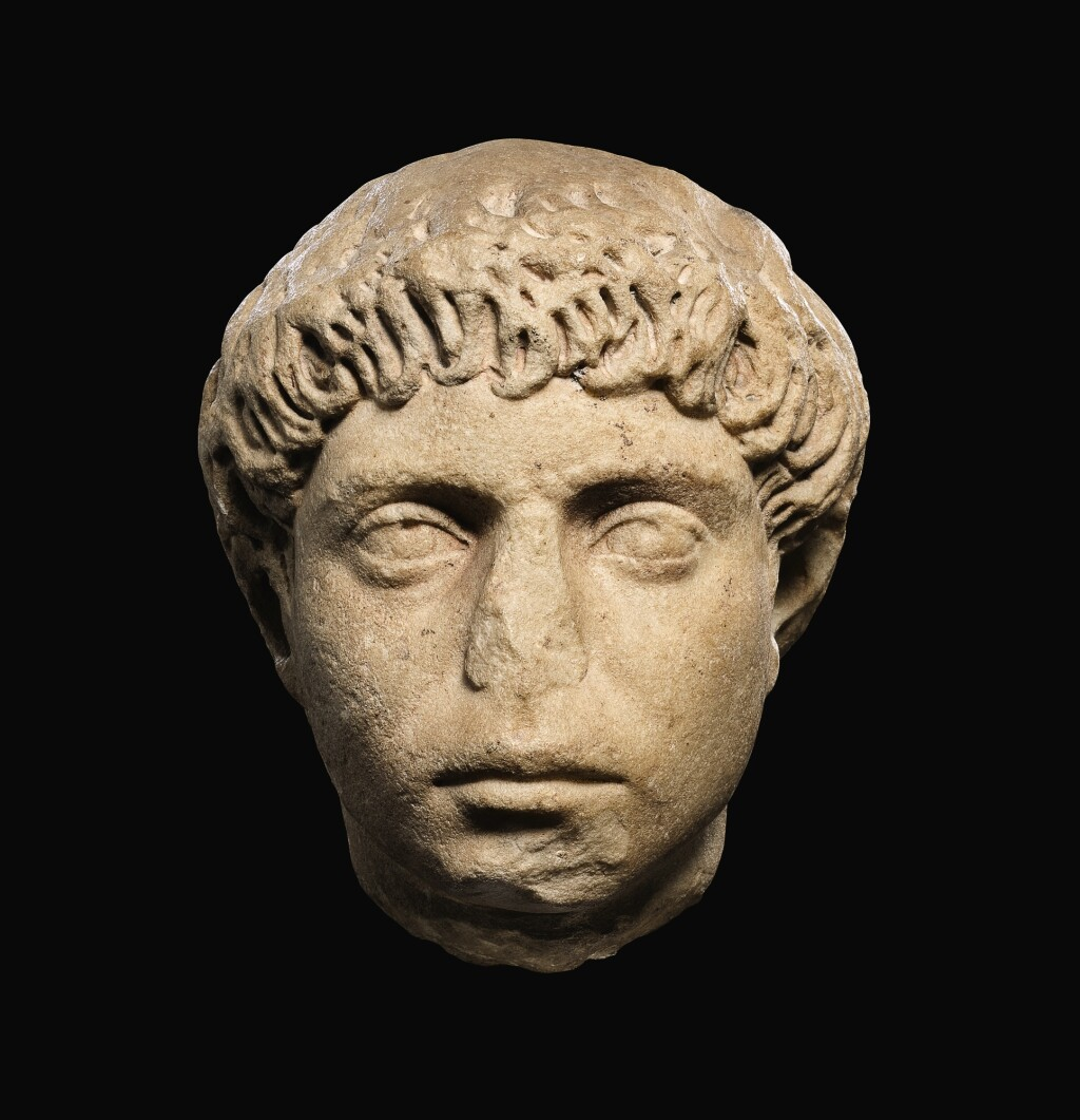 A ROMAN MARBLE PORTRAIT HEAD OF A YOUNG MAN, HADRIANIC, CIRCA A.D. 130-140