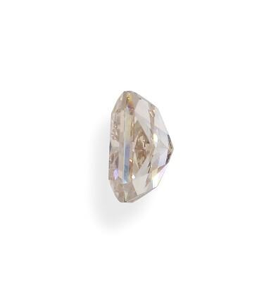 View 4. Thumbnail of Lot 1. A 6.14 Carat Fancy Brown-Orange Cut-Cornered Rectangular Modified Brilliant-Cut Diamond, VS1 Clarity.