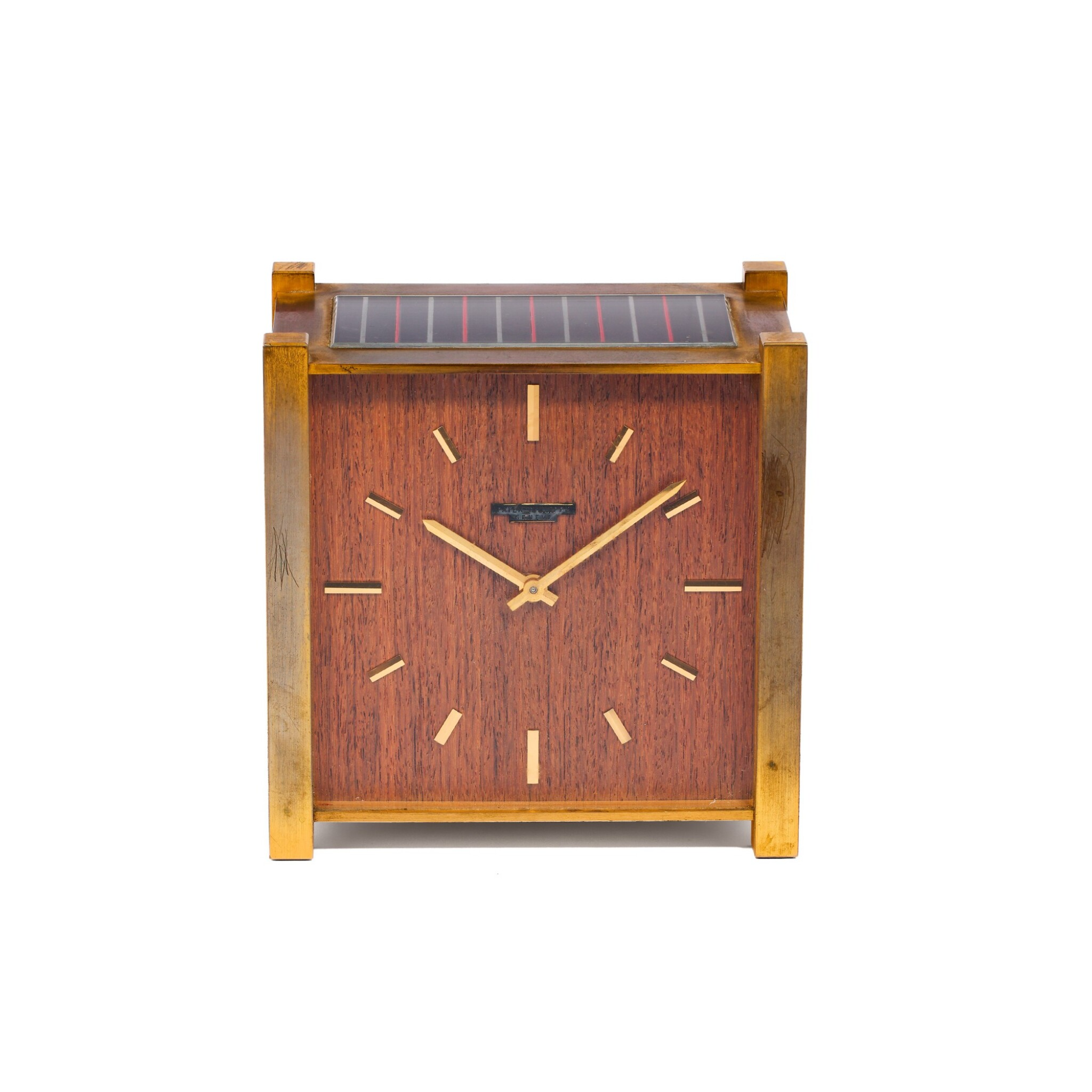 View full screen - View 1 of Lot 51. PATEK PHILIPPE   PENDULE CARRÉ A GILT BRASS AND WOOD SOLAR DESK TIMEPIECE, CIRCA 1960.