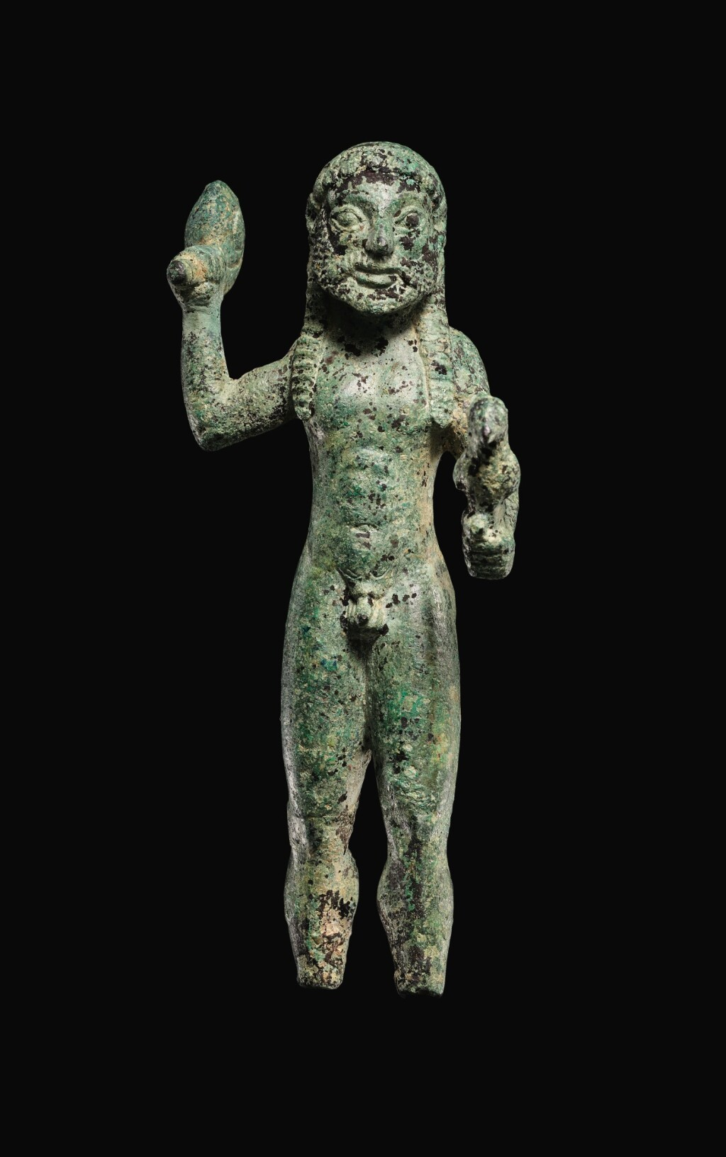 A GREEK BRONZE FIGURE OF ZEUS, 6TH CENTURY B.C.