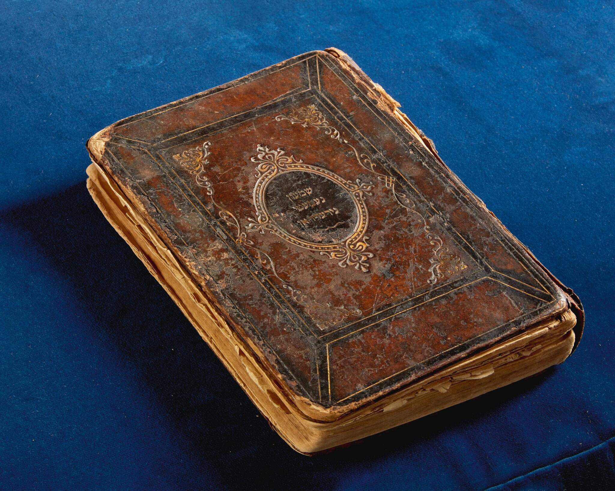 View full screen - View 1 of Lot 181. SIDDUR (DAILY PRAYER BOOK) USED BY THE SATMAR REBBE, RABBI JOEL TEITELBAUM, IN THE BERGEN-BELSEN CONCENTRATION CAMP IN 1944.