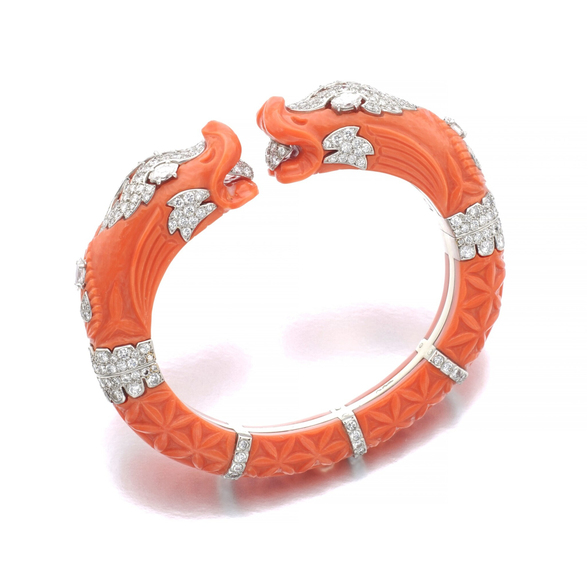 View full screen - View 1 of Lot 11. CARTIER   CORAL AND DIAMOND BANGLE, CIRCA 1970.