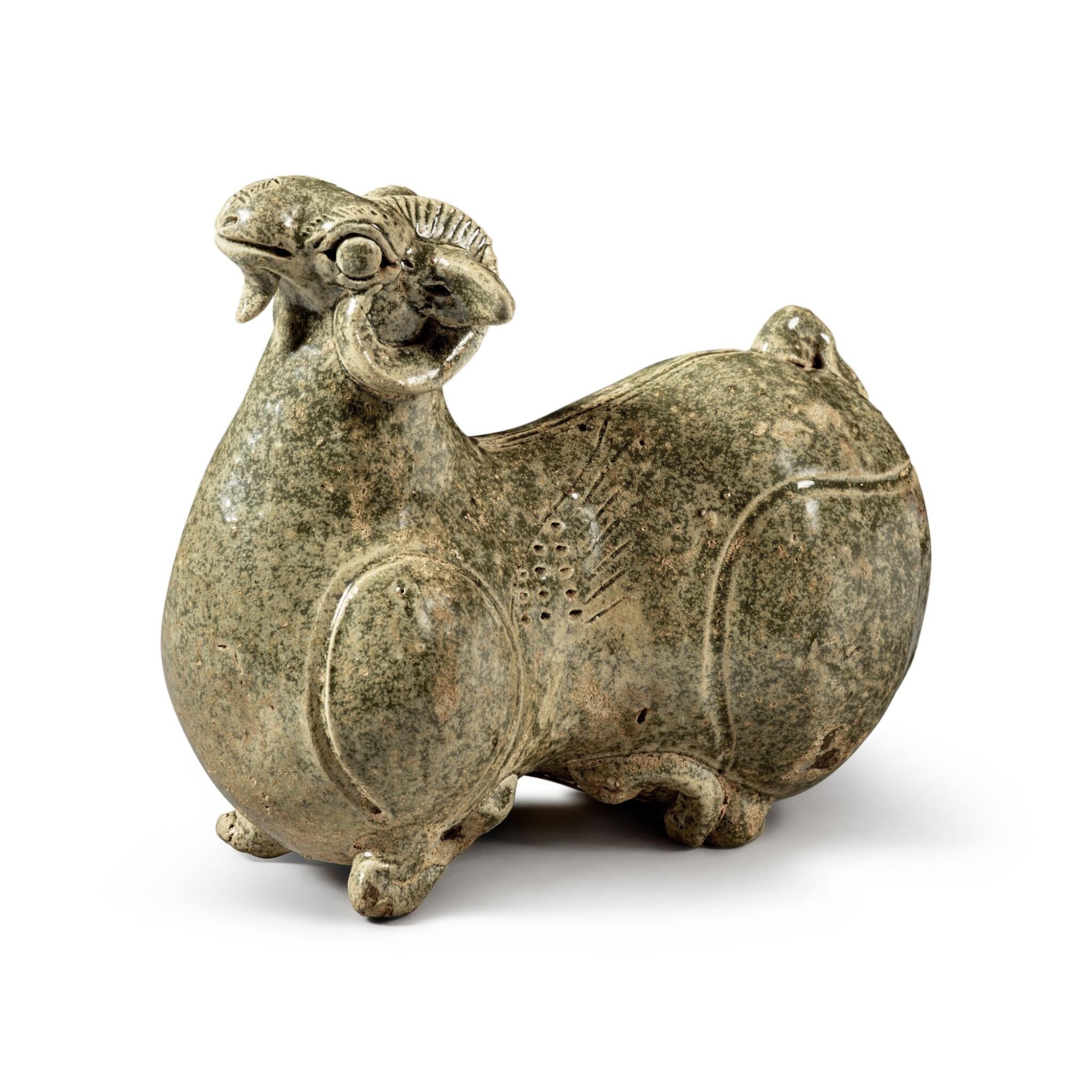 View full screen - View 1 of Lot 200. A celadon-glazed 'Yue' figure of a ram, Western Jin dynasty | 西晉 越窰青釉臥羊.