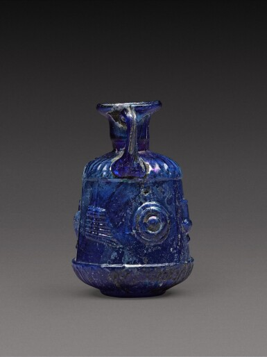 View 2. Thumbnail of Lot 3. A Roman Cobalt Blue Mould-Blown Glass Amphoriskos, circa 1st century A.D..