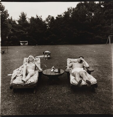 View 1. Thumbnail of Lot 9. DIANE ARBUS | 'A FAMILY ON THEIR LAWN ONE SUNDAY IN WESTCHESTER, N. Y.'.