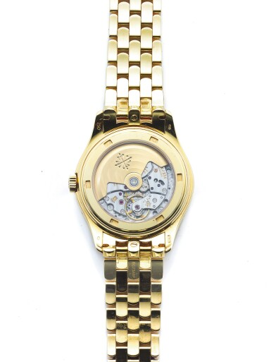 View 3. Thumbnail of Lot 152. PATEK PHILIPPE   REF 5146/1J, A YELLOW GOLD AUTOMATIC ANNUAL CALENDAR WRISTWATCH WITH MOON PHASES AND POWER RESERVE INDICATION MADE IN 2008.