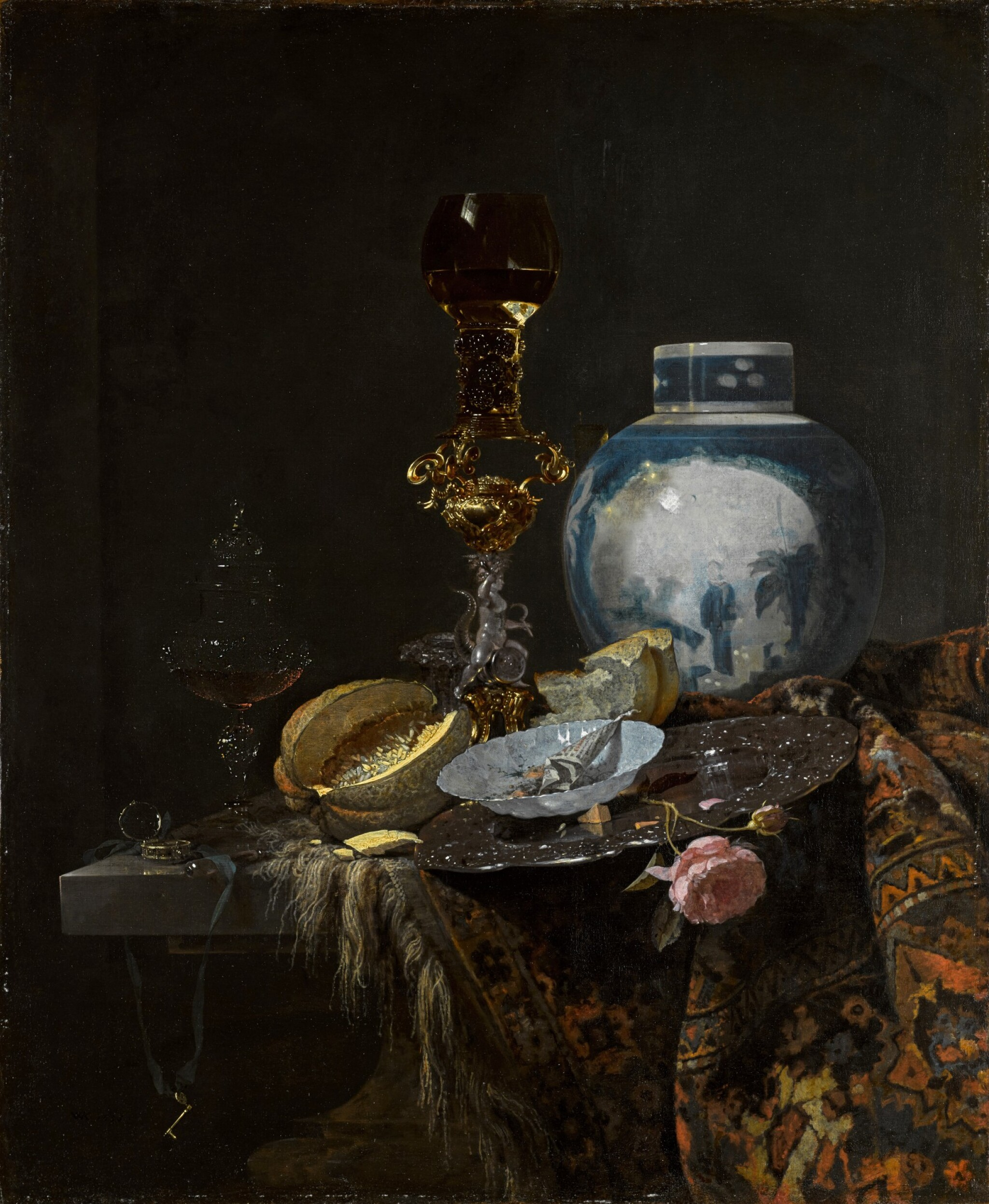 View full screen - View 1 of Lot 38. Still life with a Chinese ginger jar, silver, objects of vertu, a cut melon, bread, a paper packet in a porcelain bowl, and a pink rose, all on a table draped with a Persian carpet | 《靜物:桌上的瓷薑罐、古董銀器、切開的蜜瓜、麵包、瓷碟上的紙捲與粉紅玫瑰,桌面鋪波斯毛毯》.